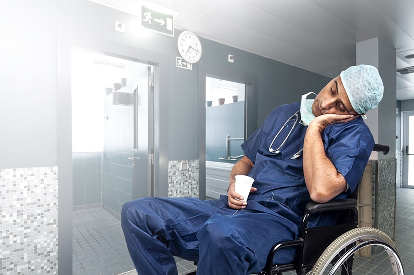 emergency doctor sleeping in a wheel chair
