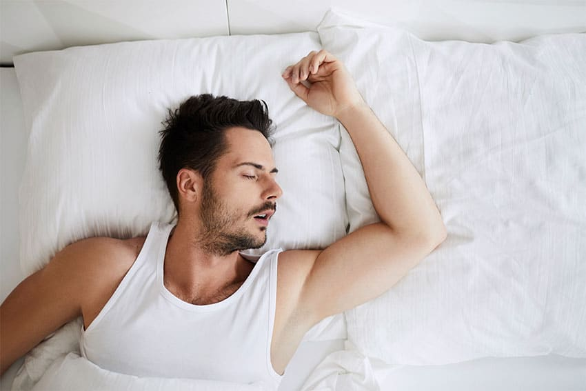 muscular man sleeping in bed, snoring
