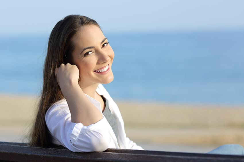 attractive young woman enjoying the beach