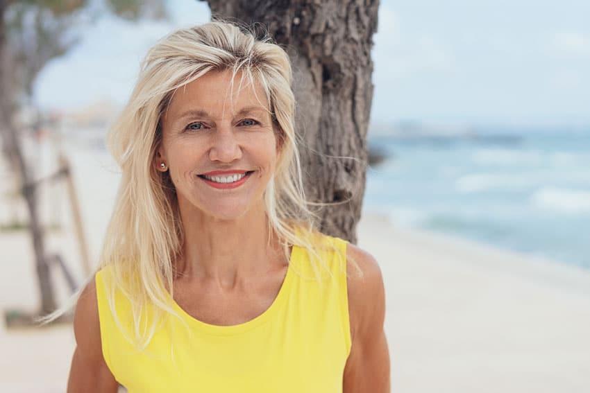 mature woman enjoying the beautiful beach